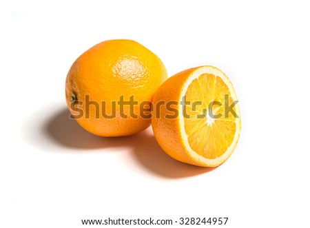 Whole and cut orange isolated on white - stock photo