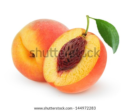 Whole and cut peaches over white background - stock photo