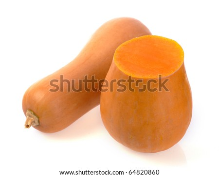 whole and half a pumpkin on a white background - stock photo