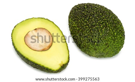 whole and half avocados isolated on white background - stock photo