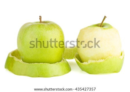 Whole and peeled green apples isolated on white background - stock photo