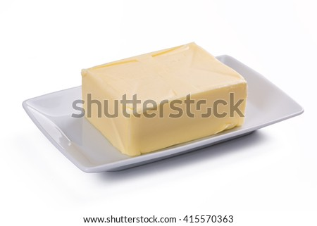 whole block butter on white plate isolated on white background - stock photo