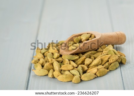 Whole Cardamom Seeds with a Wooden Spoon.Copy Space.  - stock photo