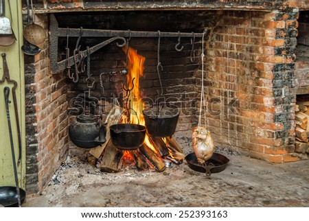 Whole Chicken Being Cooked in Vintage Fireplace - stock photo