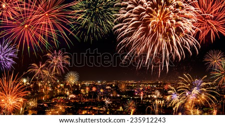 Whole city celebrating the New Year or any national event with delightful fireworks, copyspace on the night sky - stock photo
