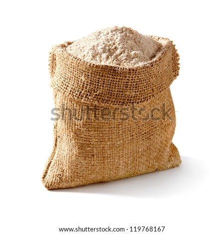 Whole flour in bag on white background - stock photo