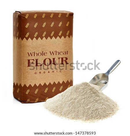 Whole flour in paper bag with flour pile on white background - stock photo