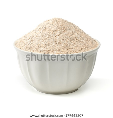 Whole flour in porcelain bowl on white background - stock photo