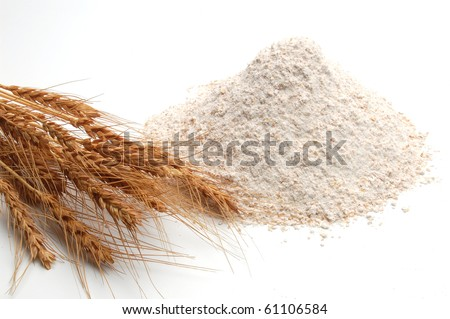 Whole flour on white with wheat ears - stock photo