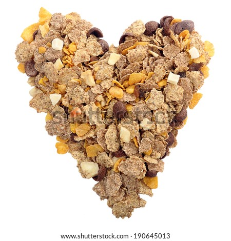 Whole grain muesli and bran breakfast in shape of heart - stock photo