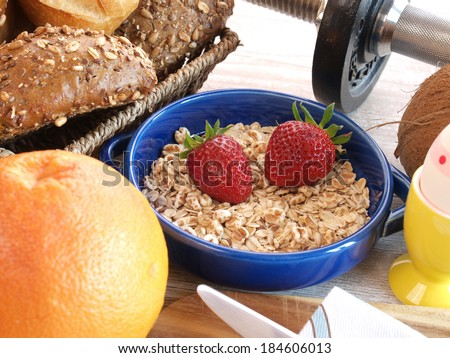 Whole grain rolls with fresh fruits and sports equipment - stock photo