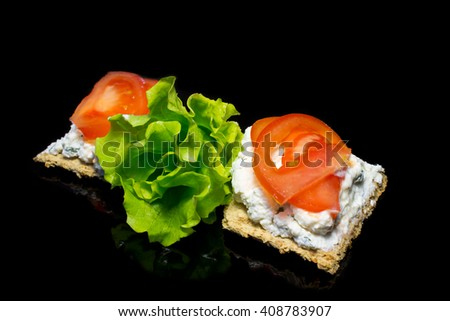 whole grain sandwiches with cheese and tomatoes on the black background - stock photo