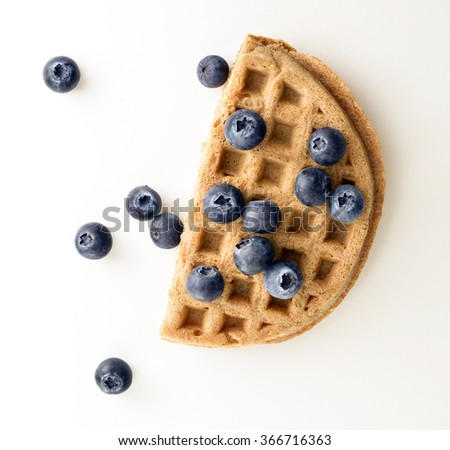 Whole grain waffle with blueberries - stock photo