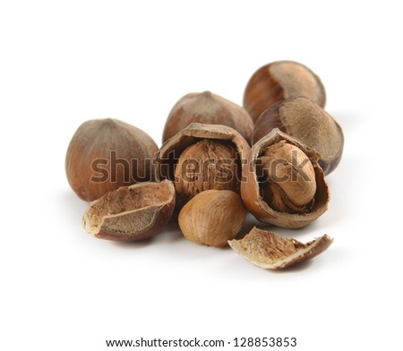 whole hazelnuts and nuts on a white background - stock photo