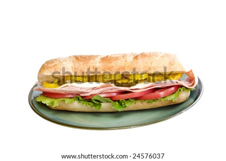 Whole Italian submarine sandwich on a plate, isolated on white background with copy space - stock photo
