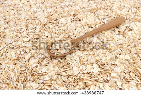 Whole muesli oat with wooden spoon ON TOP - stock photo