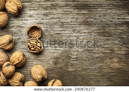 Whole nuts on a wooden background - stock photo