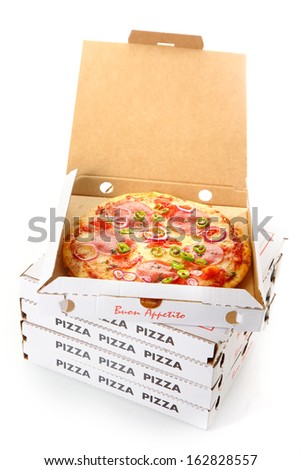 Whole pepperoni pizza in an open cardboard takeaway pizza box waiting for delivery from the pizzeria to a customer at home - stock photo