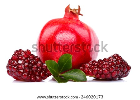 Whole pomegranate with seeds in the front - stock photo