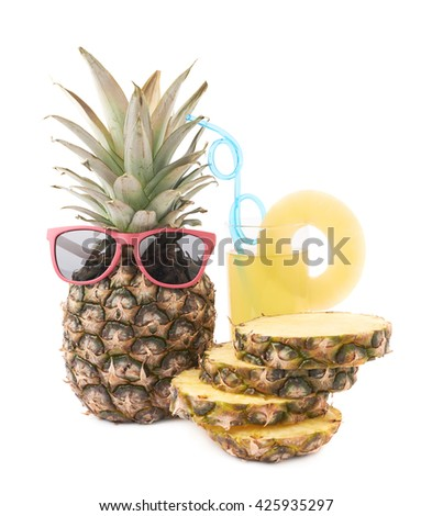 Whole raw fresh pineapple with glass of its juice isolated over white background - stock photo