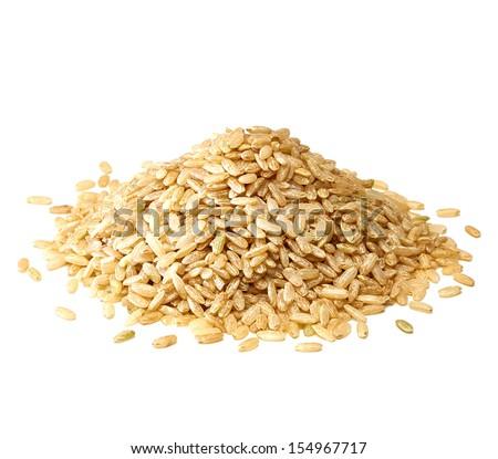 Whole rice pile on white background - stock photo