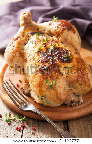 whole roasted chicken with pepper and thyme - stock photo