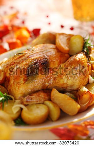 Whole roasted chicken with potatoes and apples - stock photo