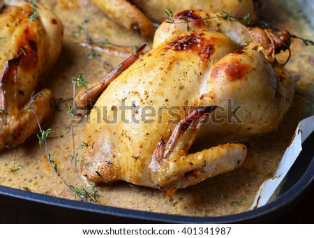 Whole Roasted Chicken with sauce on baking tray - stock photo