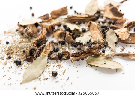 Whole Spices Mix with Dried Porcini Mushrooms, Bay Leaves, Juniper Berries, Black Pepper Corns, Thyme and Salt - stock photo