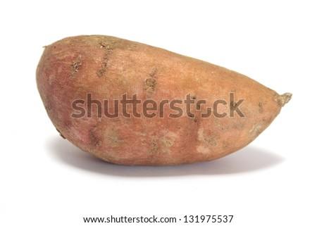Whole sweet potato isolated on white - stock photo
