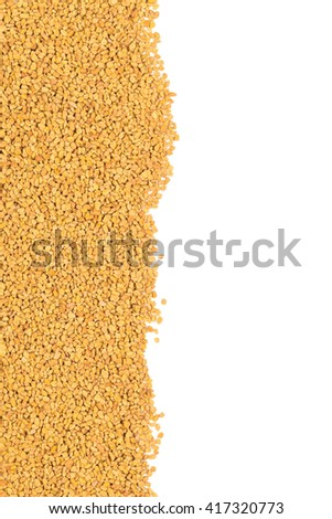 Whole, unprocessed fenugreek (Trigonella foenum-graecumcumin) seeds border on white background - stock photo