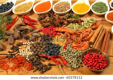 Whole variety of colorful spices. Assortment of cuisine ingredients in ceramic containers. - stock photo