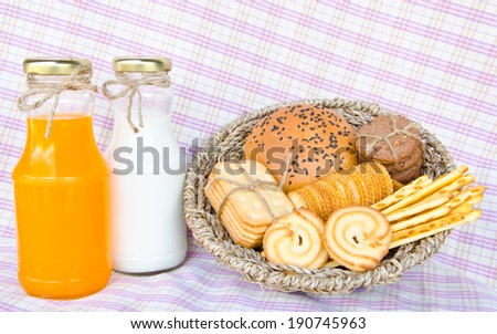 Whole wheat bread and biscuits in Basket weave - stock photo