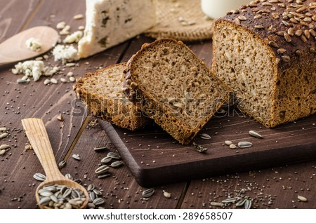 Whole wheat bread baked at home, bio ingredients, very healthy with seeds - stock photo