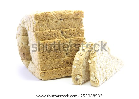 Whole wheat bread gold bottom bake with sandwich sliced on white background - stock photo