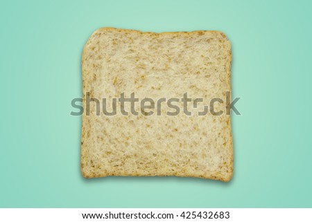 Whole wheat bread on color background / Whole wheat bread - stock photo