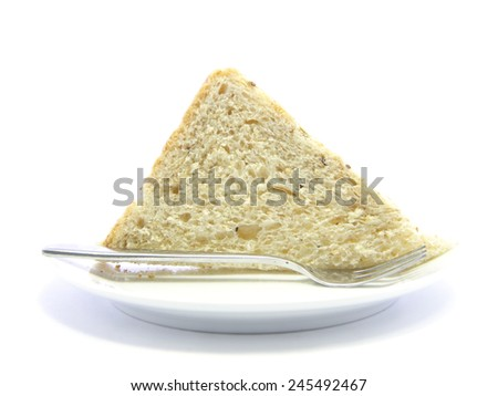 Whole wheat breakfast bread sandwich sliced on white plate and white background - stock photo