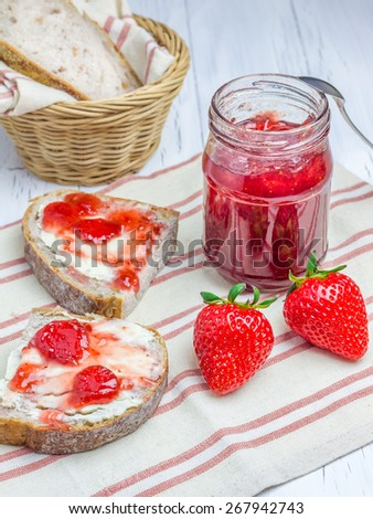 Whole wheat nut bread with cream cheese and strawberry jam - stock photo