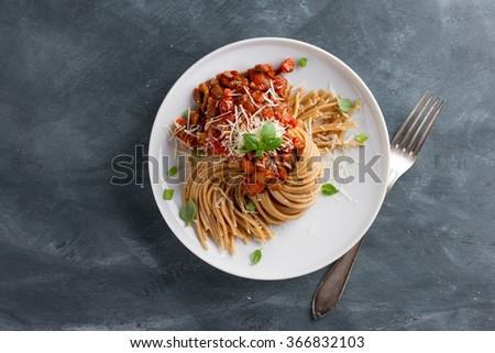 Wholegrain pasta spaghetti with vegetable sauce, selective focus - stock photo