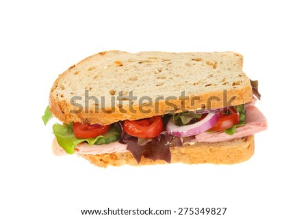 Wholemeal bread ham salad sandwich isolated against white - stock photo