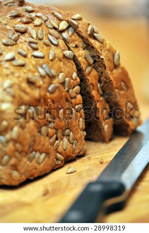 Wholemeal bread with knife - stock photo