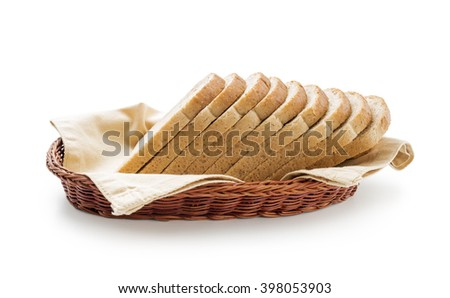Wholemeal toast bread slices placed over cotton cloth in a wicker basket isolated on white background - stock photo