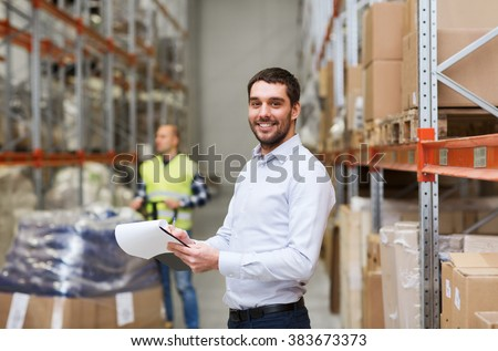 wholesale, logistic, people and export concept - happy businessman or supervisor with clipboards at warehouse - stock photo
