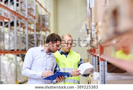 wholesale, logistic, people and export concept - manual worker and businessmen with clipboard and box at warehouse - stock photo