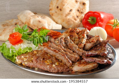 Wholesome platter of mixed meats including grilled steak - stock photo