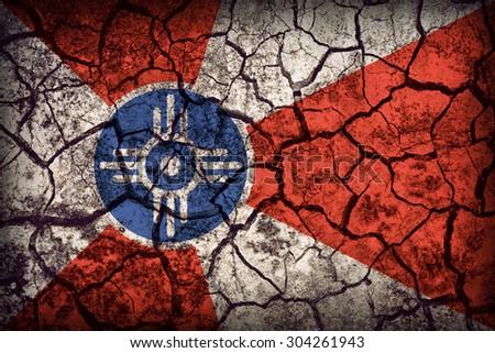 Wichita ,Kansas flag pattern on crack soil texture,retro vintage style - stock photo