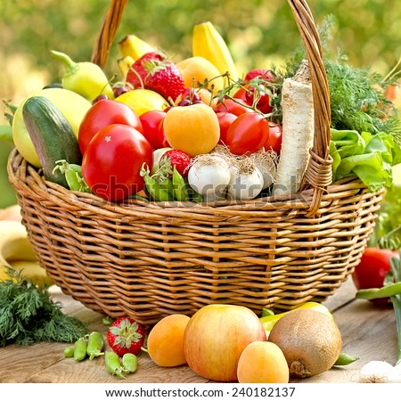 Wicker basket full of healthy food (organic and fresh food) - stock photo