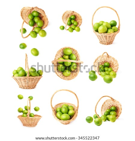 Wicker basket full of multiple ripe green limes, composition isolated over the white background, set of nine different foreshortenings - stock photo