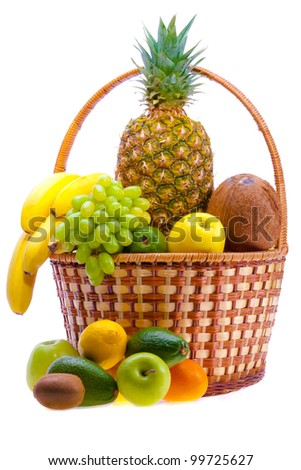 wicker basket full of the ripe fruit - stock photo