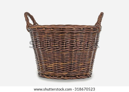 wicker basket isolated on a white background - stock photo